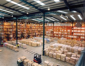indoor warehouse storage facility packed with boxes